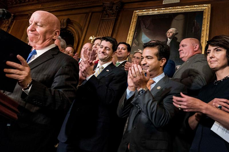 Speaker of the House Paul Ryan, along with his leadership, celebrate passing the House tax bill.