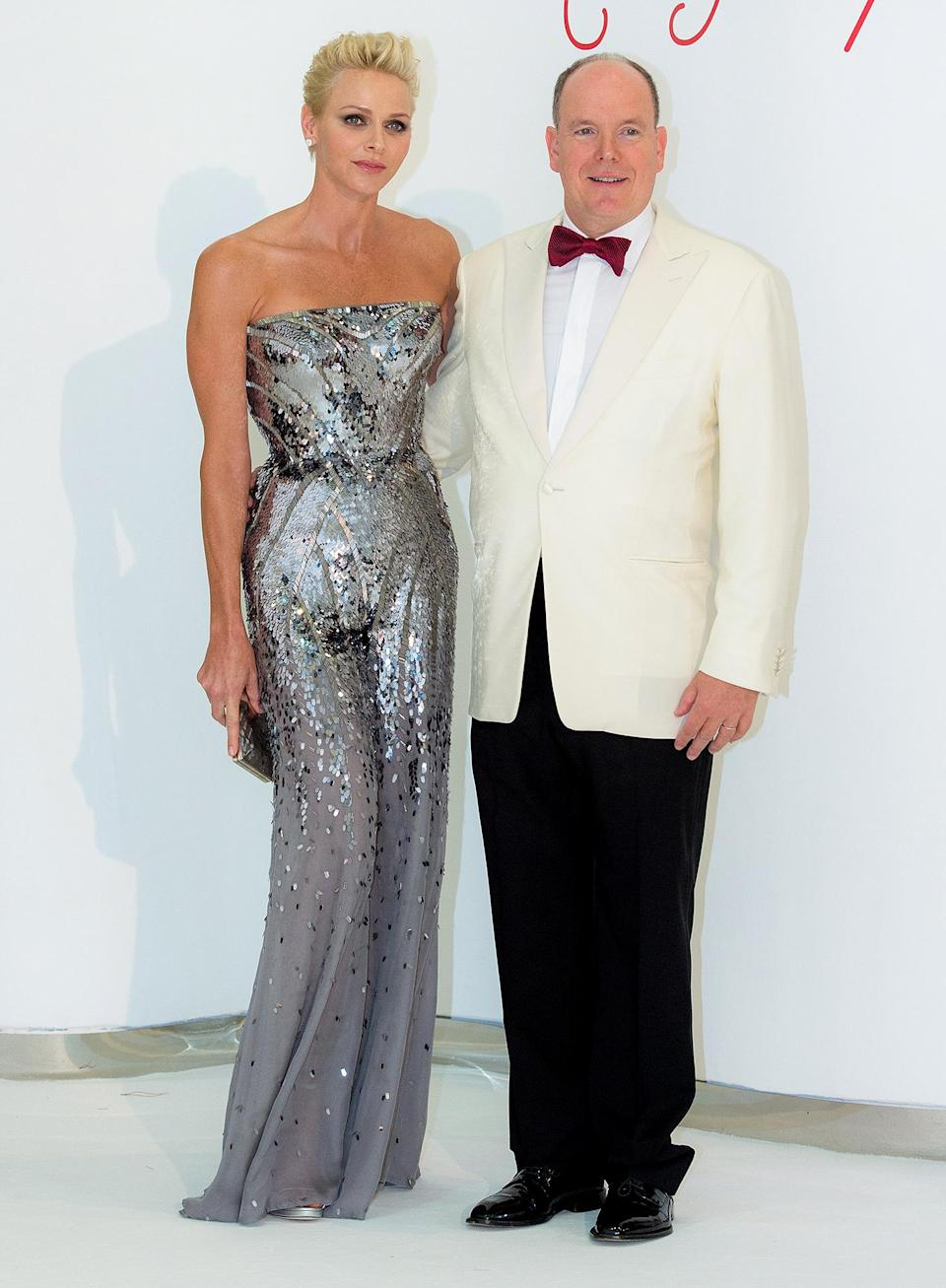 <p>For the 60th Red Cross Ball, Princess Charlene of Monaco looked exquisite in an Atelier Versace custom-made jumpsuit.</p>