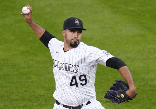 Senzatela pitches 1st complete game as Rockies top A's 3-1