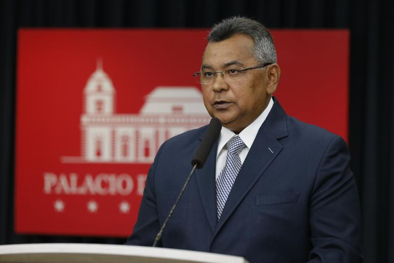 Minister of Internal Affairs, Justice and Peace, Nestor Reverol speaks during a press conference where he presented photos he said linked opposition leader and self-proclaimed President Juan Guaido with Colombian paramilitaries, in Caracas, Venezuela, Friday September 13 of 2019.The photos he presented were allegedly taken in February when Guaido crossed into Colombia and appeared at a concert held by billionaire Richard Branson. Guaido said he had photos taken with many people and has no way of knowing each individual's background. (AP Photo/Leonardo Fernandez)