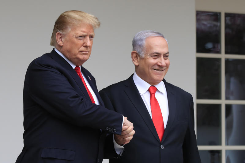 FILE - In this March 25, 2019, file photo, President Donald Trump welcomes visiting Israeli Prime Minister Benjamin Netanyahu to the White House in Washington. Netanyahu's recent troubles have some parallels to those of his good friend Trump. Both face an array of corruption allegations, both have lashed out at the media and investigators, and both suffered major setbacks this week at the hands of career government officials. (AP Photo/Manuel Balce Ceneta, File)