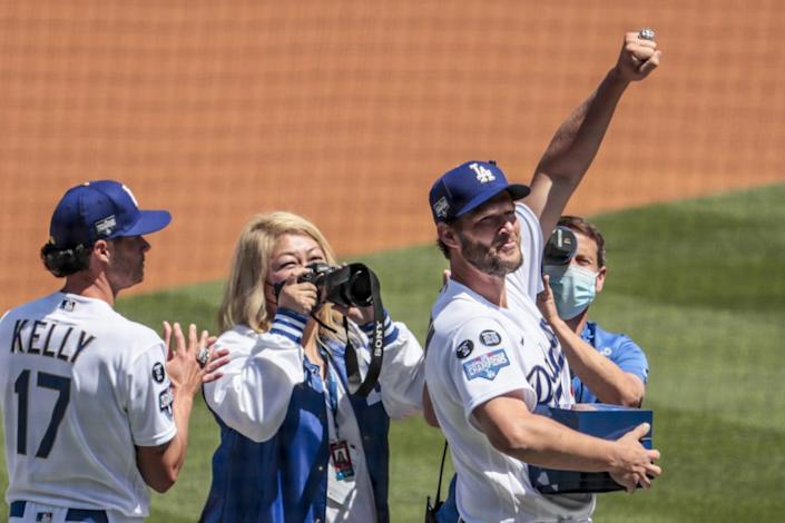 Dodgers pitcher Clayton Kershaw shows off his 2020 World Series ring during a pregame ceremony.