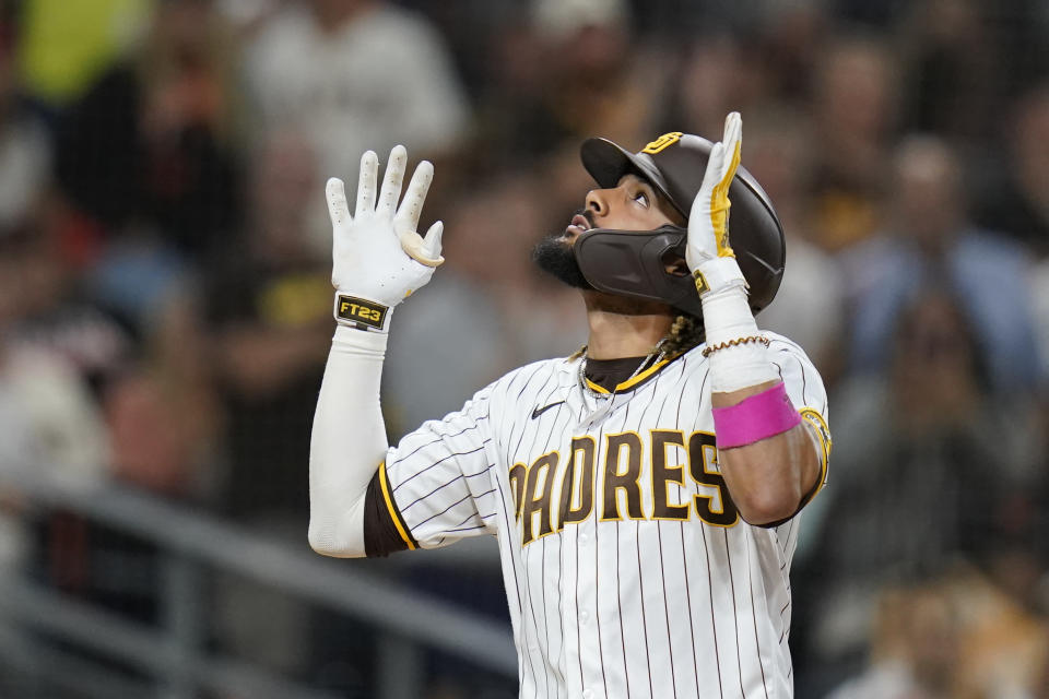 San Diego Padres' Fernando Tatis Jr. reacts after hitting a home run during the seventh inning of a baseball game against the San Francisco Giants, Wednesday, Sept. 22, 2021, in San Diego. (AP Photo/Gregory Bull)