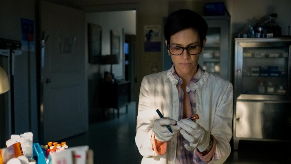 Annabeth Gish as Doctor Sarah in her lab in Midnight Mass.