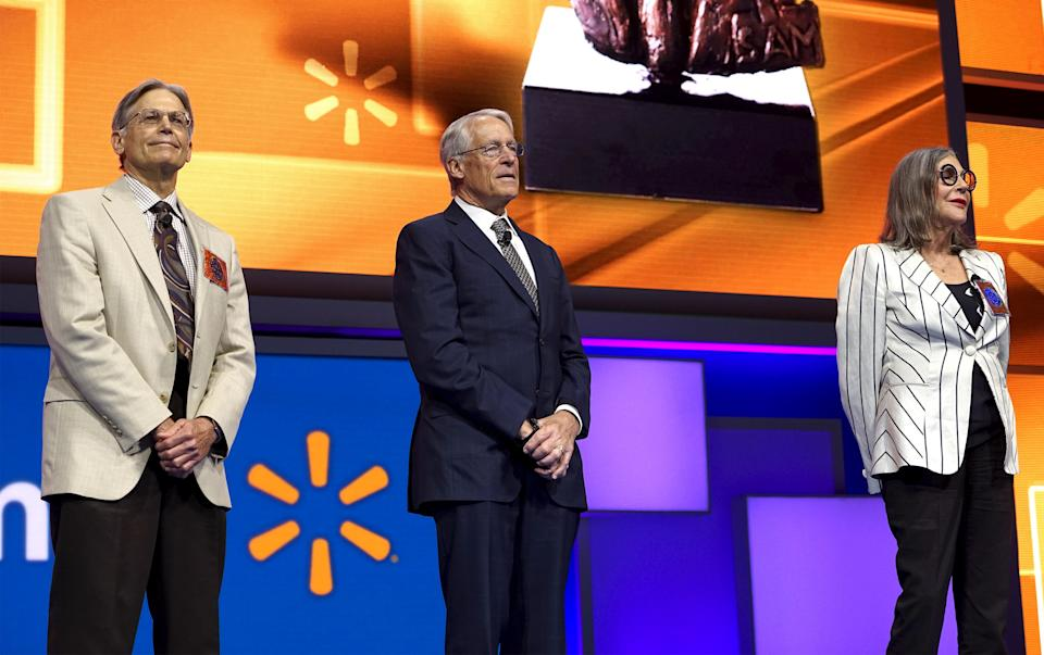 Walton family members (L to R) Jim, Rob and Alice Walton speak onstage at the Wal-Mart annual meeting in Fayetteville, Arkansas, June 5, 2015. Wal-Mart Stores Inc named Vice Chairman Greg Penner as its new chairman on Friday, replacing his father-in-law Rob Walton and cementing the founding family's influence over the board of the world's largest retailer. REUTERS/Rick Wilking