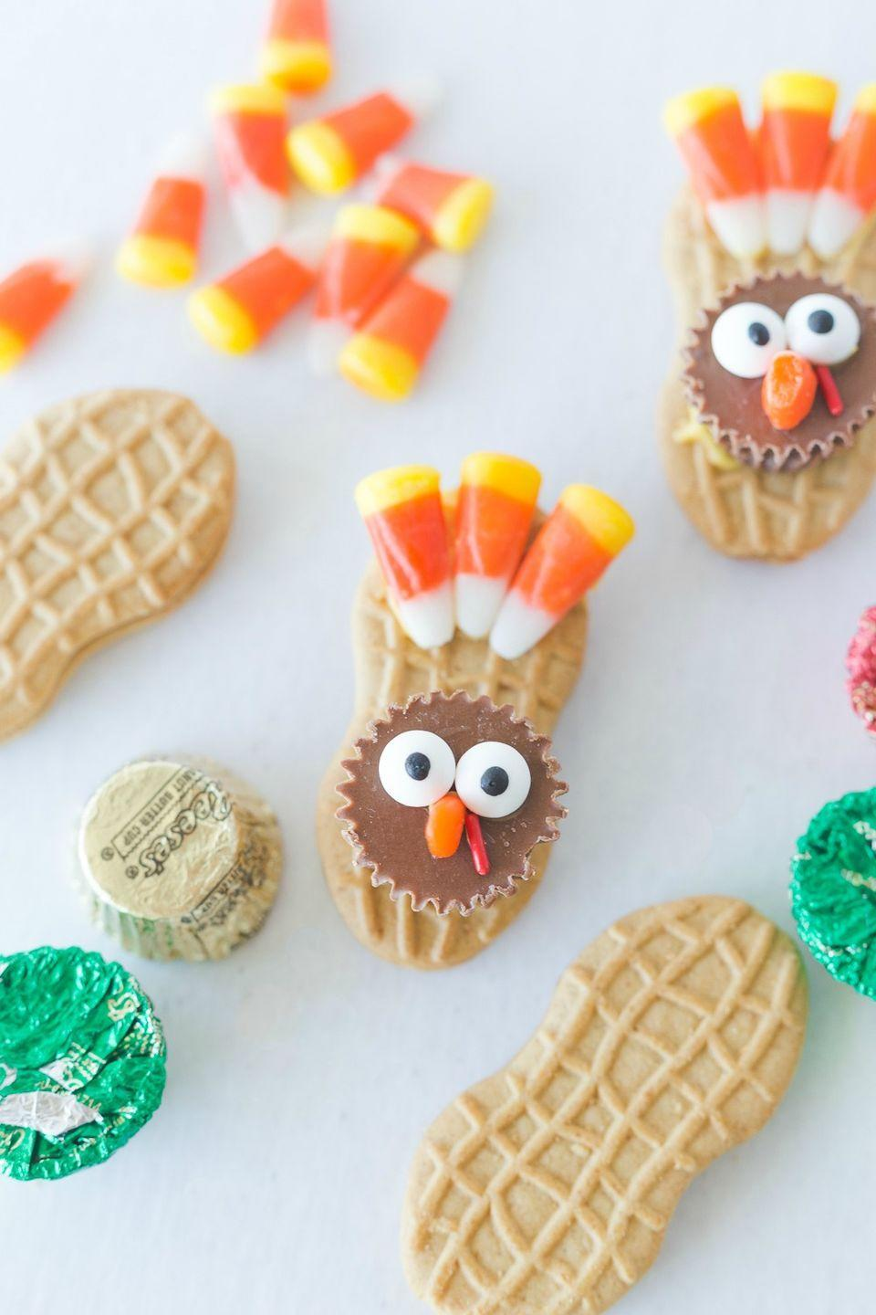 "<p>A craft and snack in one, these candy-covered Thanksgiving cookies are sure to bring the holiday fun. </p><p><strong>Get the tutorial at <a href=""https://www.iheartnaptime.net/nutter-butter-turkey-cookies/"" rel=""nofollow noopener"" target=""_blank"" data-ylk=""slk:I Heart Naptime"" class=""link rapid-noclick-resp"">I Heart Naptime</a>.</strong></p><p><a class=""link rapid-noclick-resp"" href=""https://www.amazon.com/Zachary-Confections-Corn-Candy-Pound/dp/B002MYF3T0/?tag=syn-yahoo-20&ascsubtag=%5Bartid%7C10050.g.22626432%5Bsrc%7Cyahoo-us"" rel=""nofollow noopener"" target=""_blank"" data-ylk=""slk:SHOP CANDY CORN"">SHOP CANDY CORN</a></p>"