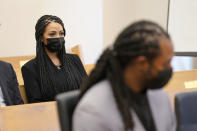 Ashley Sherman, left, looks on during a hearing for her husband, NFL football player Richard Sherman, right, in King County District Court Friday, July 16, 2021, in Seattle. Prosecutors in Washington state have charged Sherman, who has played for the Seattle Seahawks and the San Francisco 49ers, after police said he drunkenly crashed his SUV in a construction zone and tried to break into his in-laws' home. (AP Photo/Ted S. Warren)