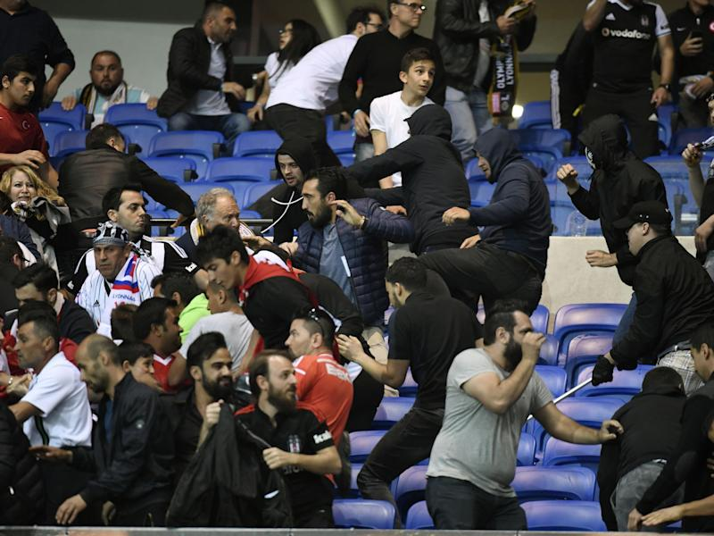 There were unsavoury scenes in the stands forcing kick-off to be delayed: AFP/Getty Images