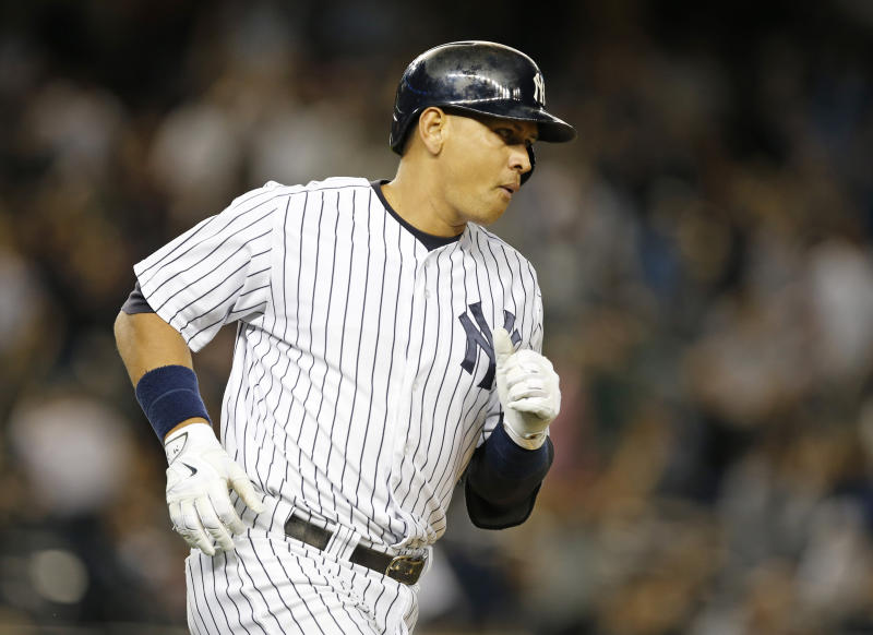 New York Yankees designated hitter Alex Rodriguez after hitting a solo-home run off Boston Red Sox pitcher Matt Barnes during the sixth inning of a baseball game in New York, Wednesday, Sept. 30, 2015. (AP Photo/Kathy Willens)