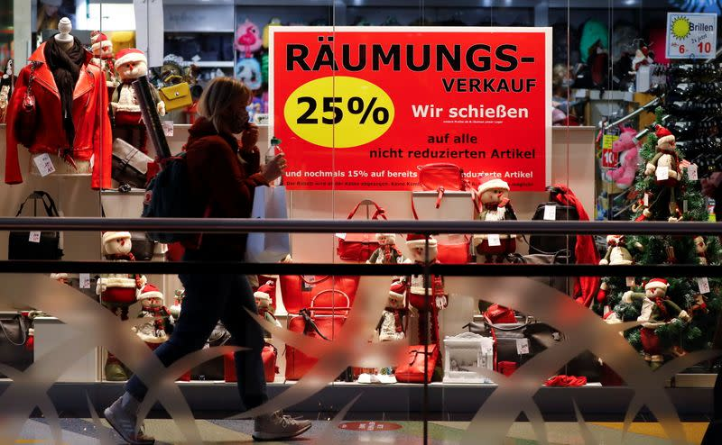 A woman walks past a shop window with a Christmas theme amid the coronavirus disease (COVID-19) outbreak in Berlin
