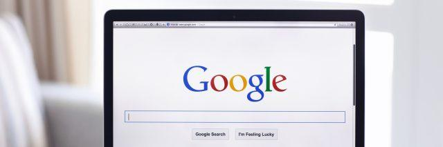 MacBook Pro Retina with Google home page on the screen
