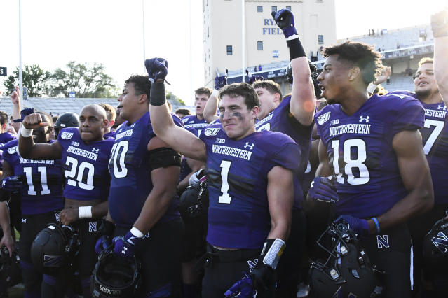 Northwestern players celebrate after an NCAA college football game against UNLV, Saturday, Sept. 14, 2019, in Evanston, Ill. Northwestern won 30-14. (AP Photo/Matt Marton)