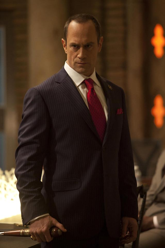 Christopher Meloni as Roman, the guardian of the Vampire Authority