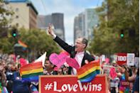 <p>DOMA plaintiffs Stuart Gaffney and John Lewis celebrate at San Francisco Gay Pride after the Supreme Court's decision to legalize same-sex marriage across the country.</p>