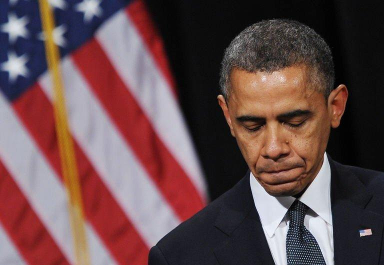 US President Barack Obama speaks during a memorial service for the victims of the Sandy Hook Elementary School shooting on December 16, 2012 in Newtown, Connecticut. Obama has vowed to battle gun violence, casting the fight as a nation's duty to protect its young, as the Connecticut town of Newtown prepared to bury the first two victims of last week's rampage at an elementary school