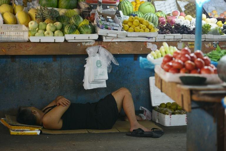 A vendor takes a rest in a market in Shanghai on July 15, 2013
