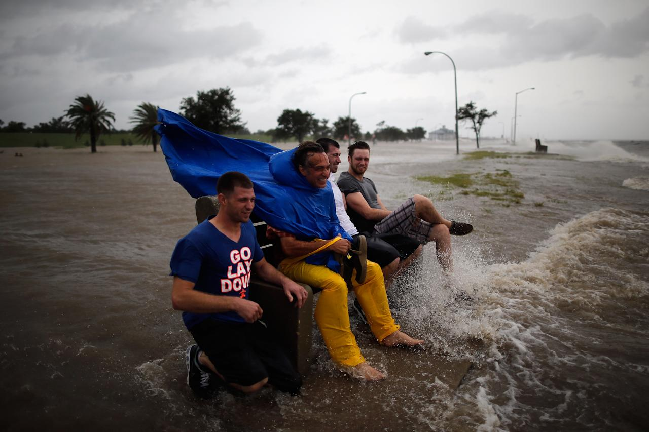 NEW ORLEANS, LA - AUGUST 28:  A group of men sit on a bench at the edge of Lake Pontchatrain as Hurricane Isaac approaches on August 28, 2012 in New Orleans, Louisiana.  Hurricane Isaac is expected to make landfall later today along the Lousiana coast.  (Photo by Chris Graythen/Getty Images)