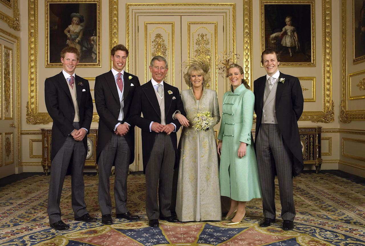 In this image released Sunday, April 10, 2005 by Clarence House, Charles, the Prince of Wales, and his new bride Camilla, Duchess of Cornwall, pose with their children: left to right, Prince Harry, Prince William and Laura and Tom Parker Bowles in the White Drawing Room at Windsor Castle in Windsor, England, after their wedding ceremony, Saturday, April 9, 2005. (AP Photo/Hugo Burnand, Clarence House)