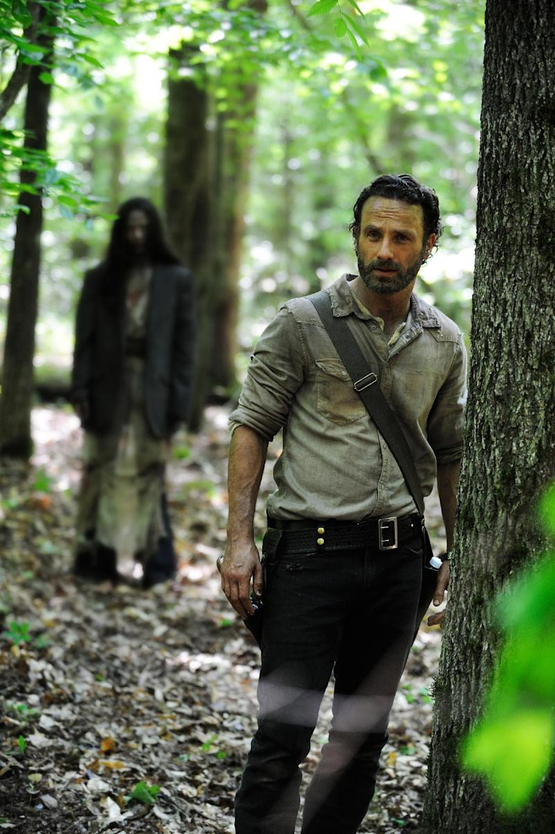 """This publicity photo released by AMC shows, Andrew Lincoln, right, as Rick Grimes, in a scene from Episode 1 of """"The Walking Dead,"""" Season 4. (AP Photo/AMC, Gene Page)"""