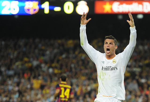 Real Madrid's Cristiano Ronaldo from Portugal reacts during the Spanish La Liga soccer match against FC Barcelona at the Camp Nou stadium in Barcelona, Spain, Saturday, Oct. 26, 2013. (AP Photo/Manu Fernandez)