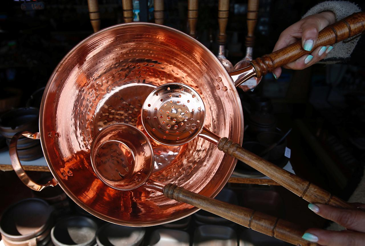 A copper frying pan is pictured in a store in Vina del Mar, Chile October 22, 2017. REUTERS/Rodrigo Garrido