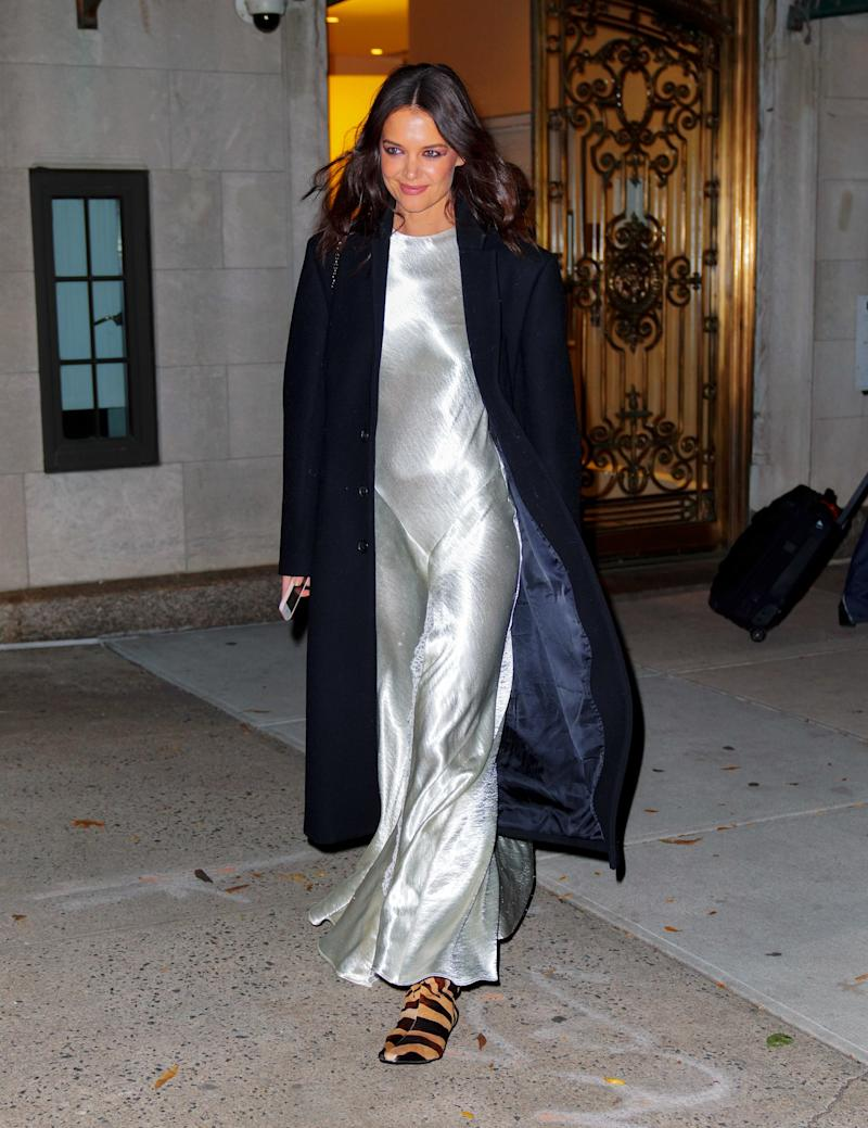Holmes wearing a Wardrobe.NYC coat, Philosophy di Lorenzo Serafini dress, and Khaite boots in New York City on November 6, 2019.