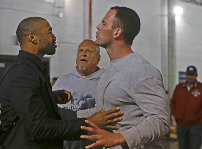 Los Angeles Dodgers' Matt Kemp, left, is stopped by San Diego Padres' Clayton Richard when Kemp confronted the Padres' Carlos Quentin in the tunnel walk-way exiting Petco Park following the baseball game between the Los Angeles Dodgers and San Diego Padres in which a brawl occurred when Quentin was hit by a pitch from the Dodgers' Zack Greinke in San Diego, Thursday, April 11, 2013. Greinke suffered a broken left collarbone in the brawl. (AP Photo/Lenny Ignelzi)