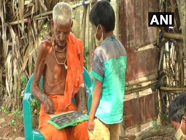 An old man has been teaching kids for free in Odisha. (Photo/ANI)