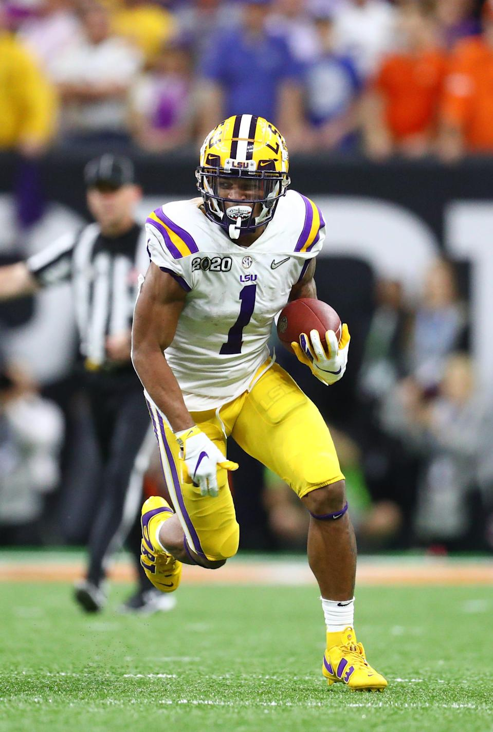 LSU receiver Ja'Marr Chase runs with the ball against Clemson in the College Football Playoff national championship game Jan. 13, 2020 in New Orleans, Louisiana.