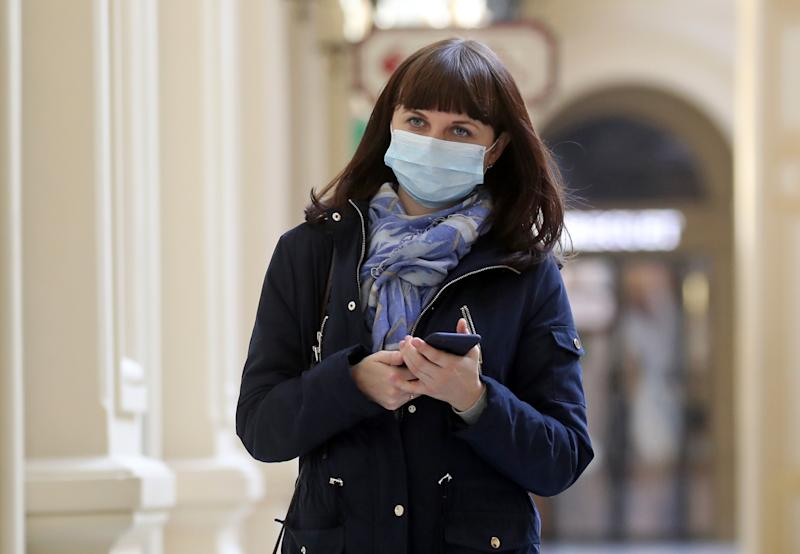 MOSCOW, RUSSIA - MARCH 25, 2020: A woman wears a face mask at the GUM department store amid the ongoing COVID-19 pandemic. Vyacheslav Prokofyev/TASS (Photo by Vyacheslav Prokofyev\TASS via Getty Images)