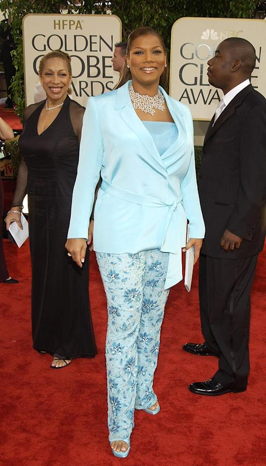 "We love Queen Latifah, but what possessed her to don this dowdy light blue ensemble in 2003? The printed pants were particularly heinous. Kevin Mazur/<a href=""http://www.wireimage.com"" target=""new"">WireImage.com</a> - January 19, 2003"