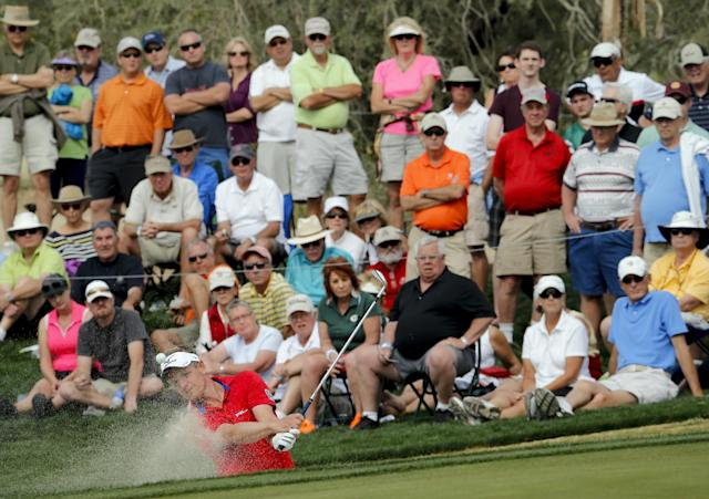 Luke Donald, of England, hits out of a bunker on the 13th hole in his match against Matteo Manassero, of Italy, during the first round of the Match Play Championship golf tournament on Wednesday, Feb. 19, 2014, in Marana, Ariz. Manassero won 5 and 4. (AP Photo/Matt York)