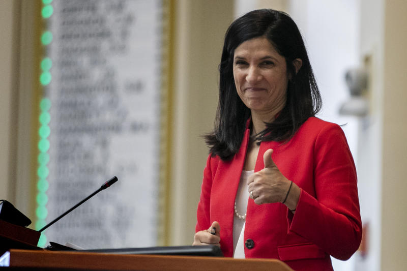 House speaker Sara Gideon, D-Freeport, flashes a thumbs up at a Democratic colleague prior to the start of the first session of the new year, Wednesday, Jan. 8, 2020, at the State House House in Augusta, Maine. (AP Photo/Robert F. Bukaty)