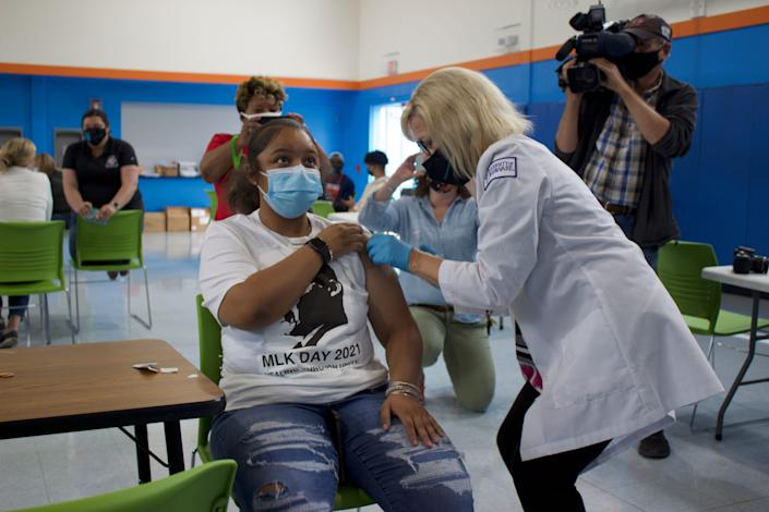 Lt. Gov. Bethany Hall-Long vaccinates Anaya Patterson, 17, at The Warehouse vaccination event in northeast Wilmington, Del., on Sunday.
