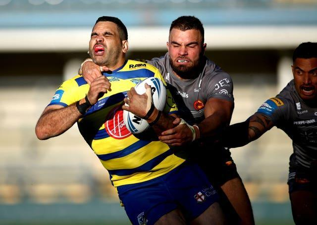 Greg Inglis, left, scored two tries in three appearances for Warrington