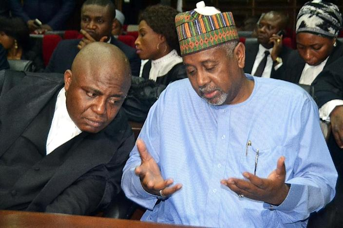 Former national security adviser of ex-president Goodluck Jonathan, Sambo Dasuki (right), speaks with his lawyer Ahmed Raji, during his trial at the federal high court in Abuja, on September 1, 2015 (AFP Photo/STRINGER)