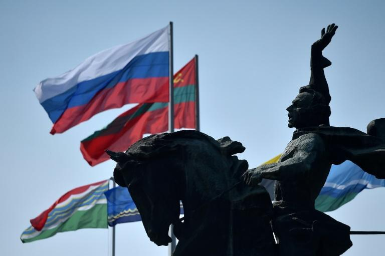 Flags of Russia and Transnistria -- which professes allegiance to Moscow -- flutter by a monument to 18th century Russian military commander Alexander Suvorovin in Tiraspol (AFP/Sergei GAPON)