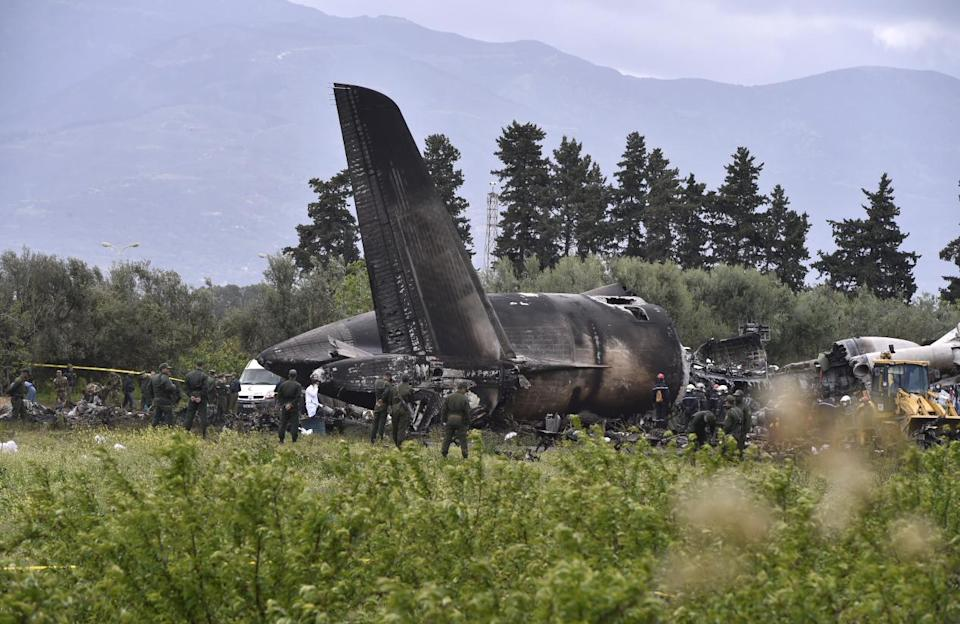<p>Rescuers are seen around the wreckage of an Algerian army plane which crashed near the Boufarik airbase from where the plane had taken off on April 11, 2018. The Algerian military plane crashed and caught fire killing 257 people, mostly army personnel and members of their families, officials said. / AFP PHOTO / Ryad KRAMDI (Photo credit should read RYAD KRAMDI/AFP/Getty Images) </p>