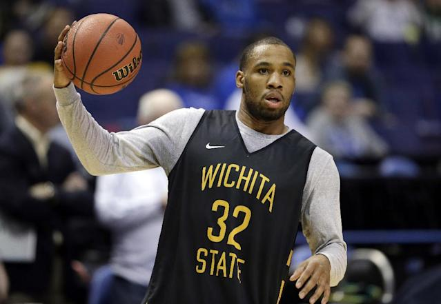 Wichita State's Tekele Cotton holds a ball during practice for the NCAA college basketball tournament Thursday, March 20, 2014, in St. Louis. Wichita State is scheduled to play against Cal Poly in a second-round game on Friday. (AP Photo/Jeff Roberson)