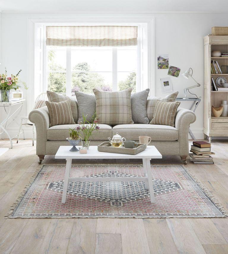 """<p>More forgiving than white, with cooler undertones than cream, a beige sofa is the picture of versatility. Maintain a cool colour scheme by pairing your sofa with greys or soft blues, or warm it up with pinks or a pop of burnt orange. </p><p>Pictured: <a href=""""https://www.dfs.co.uk/morland/rln24arld?skuId=1410559&origin=Exclusive_Brands"""" rel=""""nofollow noopener"""" target=""""_blank"""" data-ylk=""""slk:Country Living Morland Sofa at DFS"""" class=""""link rapid-noclick-resp"""">Country Living Morland Sofa at DFS</a></p>"""