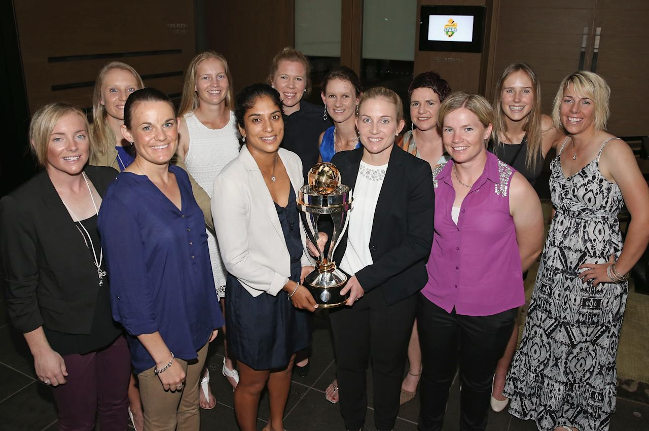 MELBOURNE, AUSTRALIA - MARCH 08:  (L to R) Sarah Coyte, Alyssa Healy, Erin Osborne, Meg Lanning, Lisa Sthalekar, Alex Blackwell, Julie Hunter, Jodie Fields, Renee Chappell, Jessica Cameron, Ellyse Perry and Elyse Villani of the Southern Stars pose with the World Cup trophy during the Australian Southern Stars World Cup celebration dinner at The Grand Hyatt on March 8, 2013 in Melbourne, Australia.  (Photo by Scott Barbour/Getty Images)ely valani