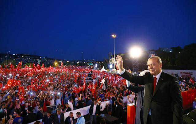 <p>Turkish President Tayyip Erdogan and his wife Emine Erdogan greet their supporters as they arrive for a ceremony marking the first anniversary of the attempted coup at the Bosphorus Bridge in Istanbul, Turkey July 15, 2017. (Photo: Kayhan Ozer/Presidential Palace/Handout via Reuters) </p>