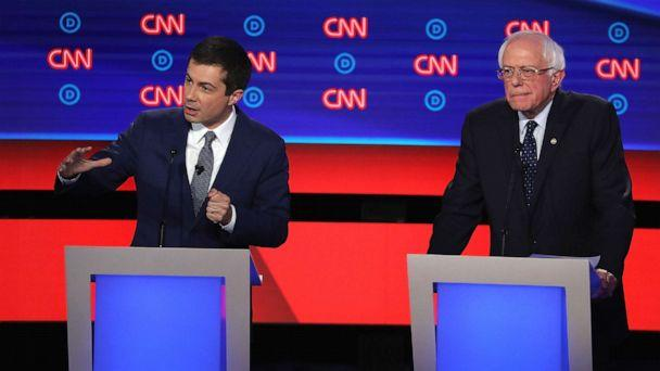 PHOTO: Democratic presidential candidate South Bend, Indiana Mayor Pete Buttigieg (R) speaks while Sen. Bernie Sanders (I-VT) listens during the Democratic Presidential Debate, July 30, 2019, in Detroit. (Justin Sullivan/Getty Images)