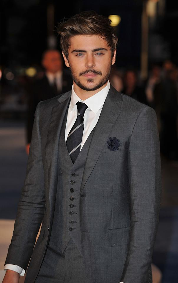 """Brad Pitt may have shaved off his beard, but Zac Efron grew one. The """"Charlie St. Cloud"""" star no longer resembles a younger, hotter Rob Lowe, and girlfriend Vanessa Hudgens is still getting used to the scruffy style. """"<a href=""""http://www.usmagazine.com/stylebeauty/news/vanessa-hudgens-zac-efrons-beard-is-growing-on-me-2010229"""" target=""""_blank"""">It's growing on me! It's growing on me!</a>"""" she declared to Us Magazine last week. Thankfully, it's only a temporary look for his upcoming film """"The Lucky One."""""""