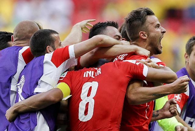 Switzerland's Haris Seferovic, right, celebrates after scoring his side's second goal during the group E World Cup soccer match between Switzerland and Ecuador at the Estadio Nacional in Brasilia, Brazil, Sunday, June 15, 2014. (AP Photo/Michael Sohn)