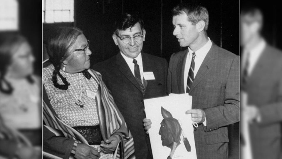 Walter Wetzel, middle, speaks with Sen. Robert F. Kennedy. Wetzel, former president of the National Congress of American Indians, is responsible for the now retired Washington Redskins logo. (Francis Miller/The LIFE Picture Collection via Getty Images)