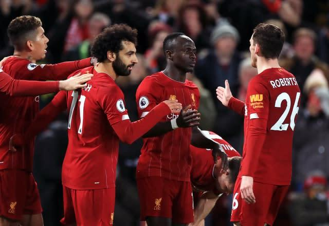 The Reds made it a year unbeaten in the top flight by beating Sheffield United 2-0 at Anfield on January 2. Goals either side of half-time from Mohamed Salah, second left, and Sadio Mane, second right, did the damage against the Blades (Peter Byrne/PA)