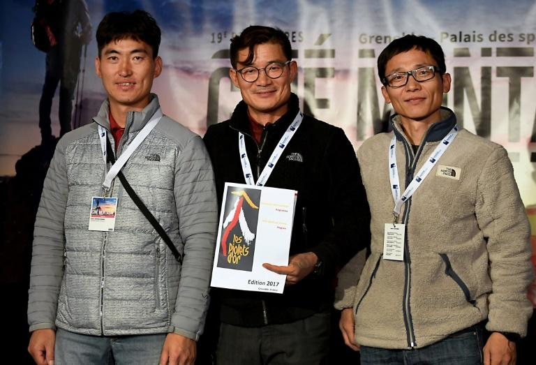 Experienced climber Kim Chang-ho, centre, was leading the expedition on Mount Gurja