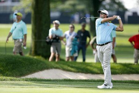 Aug 3, 2014; Akron, OH, USA; Adam Scott hits his approach shot on the 14th hole during the final round of the WGC-Bridgestone Invitational golf tournament at Firestone Country Club - South Course. Joe Maiorana-USA TODAY Sports