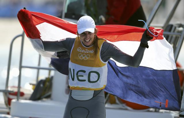 2016 Rio Olympics - Sailing - Final - Women's One Person Dinghy - Laser Radial - Medal Race - Marina de Gloria - Rio de Janeiro, Brazil - 16/08/2016. Marit Bouwmeester (NED) of Netherlands celebrates gold medal. REUTERS/Benoit Tessier FOR EDITORIAL USE ONLY. NOT FOR SALE FOR MARKETING OR ADVERTISING CAMPAIGNS.